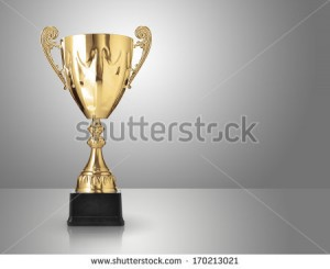 stock-photo-champion-golden-trophy-over-grey-background-170213021